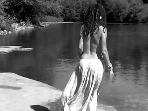 Hippie girl in flowing microskirt dancing