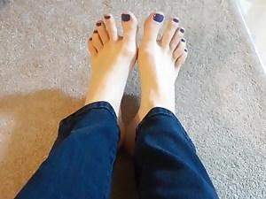 My freshly pedicured nude feet in jeans.
